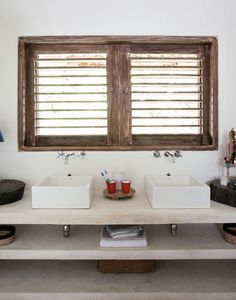 Love the rustic salvaged wood feel to all the door and window fixtures in this beautiful beach house in Brazil