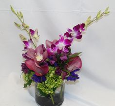 Exotic arrangement of dendro orchids, mini calla lilies, mini ngreen hydrangea, cymbidium orchids and purple statice! #florist #flowershop #flowers #florals #flowerarrangement #floralarrangement #orchids #dendrobiumorchid #orchid #minicallalily #hydrangea #hydrangeas #minicallalilies #callalily #flowerdesign #flowersoftheday #flowerlover #flowerlovers #cymbidiumorchid #cymbidiumorchids #statice #flowerslovers #flowerpower #blooms #fall #flower