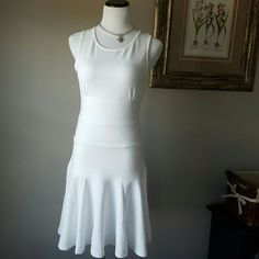 """NWOT. White dress in M Never worn. Stretchy fabric. Not lined. The fabric is not sheer. Maybe slightly if you are standing infront of the sun. Great fit. Lenght 35"""".Bundle and save  Dresses Midi"""