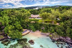 Named for high-society writer Ian Fleming, this magnificent vacation rental sits along the beachfront of the iconic GoldenEye Resort in Orcabessa. It was here on Jamaica's picturesque north coast that Fleming wrote all fourteen James Bond novels, with intermittent breaks to sip cocktails with celebrities like Katherine Hepburn and Errol Flynn. After this golden era, Island Records mogul Chris Blackwell acquired the property and expanded it into today's groovy resort.