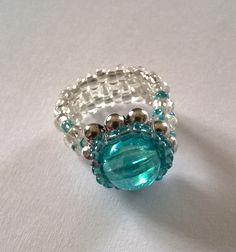 Blue beaded crystal ring with silver detail