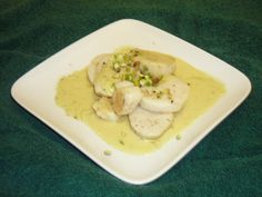 Scallops in White Wine Curry Sauce with Roasted Pistachios