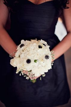 Black and white wedding.  Bouquet.  Anemones, hydrangea, roses.  {Olivier Events} Black bow and bits of silver bling innit would just be lovely