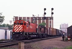 A westbound CP extra eases towards Lambton Yard in West Toronto, ON on May 30, 1980, led by M630 No. 4570.