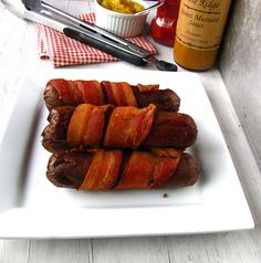 Deep Fried Bacon-Wrapped Hot Dogs (yep, you heard right) These are a little over cooked but my family loves them.