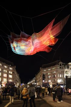 American artist Janet Echelman has suspended a giant net sculpture based on data captured from the 2011 Japanese earthquake and tsunami between buildings above London's Oxford Circus.