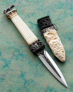 "Arpad Bojtos - Name: ""The Column Dagger"" Materials: Blade: 440 C Handle: mammoth ivory, 440 C,14 car. gold Sheath: mammoth ivory, buffalo horn, silver Description: The total lenght: 30,5 CMs."