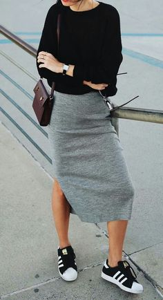 how to style a pair of black sneaker : bag + black top + grey skirt