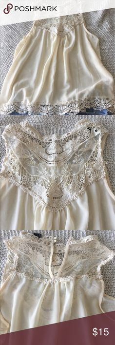 High Neck Lace Chiffon Tank Top Cream colored chiffon semi-sheer tank top with crochet/lace details. Buttons at neck. Forever 21 Tops Tank Tops