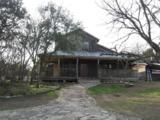 •This Hill Country style home is in need of repairs but has basic charm.  •Lots of wood incorporated into this cozy and comfortable home.