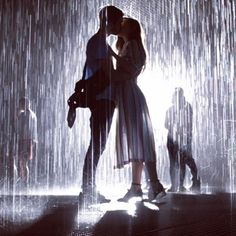 In the rain but untouched by the rain ~ Felix and Marzia kissing...