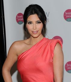 Kim's updo utilises soft, short layered pieces in front to modernise a formal look. #kimkardashian #hair