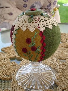 I ❤ crazy quilting & embroidery . . .  ANTIQUE STYLE PEDESTAL PIN CUSHION - Vintage stitching - closeup. Made with wool. Spider roses embroidered on panel, ric rac embroidered on seam, spider rose button edged with herringbone stitch on top. ~By Happy 2 Sew