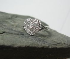 Diamond Sterling Silver Heart Promise / Engagement Ring ~ Ready to Ship Featuring ~ A lovely decorative heart with a tiny hint of diamond. setting Complimentary Shipping within the US~ Specifications~ diamond Ct Sterling Silver Heart Promise Rings, Heart Rings, Diamond Promise Rings, Diamond Heart, Ring Engagement, Unique Rings, Absolutely Gorgeous, Heart Shapes, Sterling Silver Rings