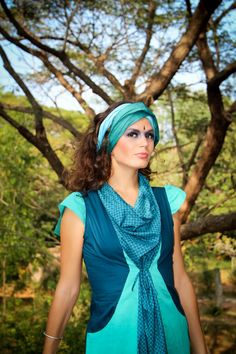 Karma dress in pure cotton of vibrant hues of turquoise. The dress is size adjustable to perfectly fit your body shape www.taklamakan.fr