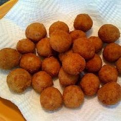 Sauerkraut Balls Recipe Lunch and Snacks, Appetizers, Main Dishes with unsalted butter, onion, chopped cooked ham, corned beef, garlic, all-purpose flour, sauerkraut, fresh parsley, beef broth, eggs, milk, all-purpose flour, dry bread crumbs, oil
