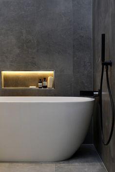sleek, modern bathroom with bathtub and shower in wet area