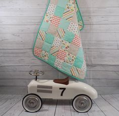 A personal favourite from my Etsy shop https://www.etsy.com/uk/listing/516218197/baby-boy-quilt-pastel-bright-colours