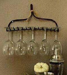 an old iron rake turned wine glass holder