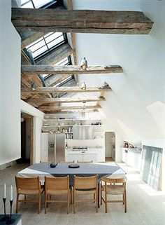 A light and open European kitchen and dining room space  (via A...