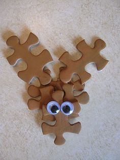 A Very Puzzling Rudolph: Cute craft to do with kids using odd puzzle pieces / http://goodideasforyou.com/mix-a-match/2184-a-very-puzzling-rudolph.html#