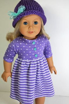 Purple polka dot and striped dress by sewurbandesigns. Made with the Baby Doll Dress pattern, found at http://www.pixiefaire.com/collections/123-mulberry-st/products/baby-p doll-dress-18-doll-clothes. #pixiefaire #babydolldress