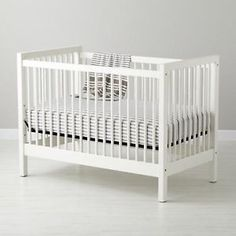Beautiful white Ikea baby crib $100. Comes with fitted sheet, Sealy mattress, skirt, padding, and crib toy