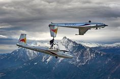 Holding plane while standing on another plane by Markus Zinner | Red Bull