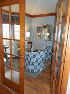 Den interior decoration including fabrics, paint color and decor, by Jane Barlow of Adaptations Interior Design.