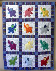 Elephant Treasures handmade quilt by Serenstitches on Etsy