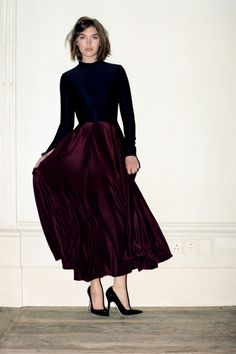 Plum red full maxi skirt, dark blue long sleeve blouse and black pumps outfit. The luxe of the simplicity. Trager Delaney, 2013.