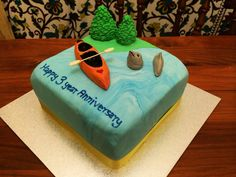 Port Adelaide themed kayak cake