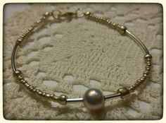 Check out this item in my Etsy shop https://www.etsy.com/listing/270796390/pearl-golden-bracelet