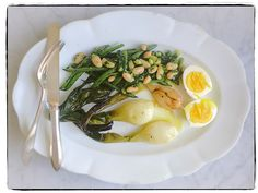 """We poached succulent spring onions then marinated some in agrodolce sauce, made a two bean salad—green beans and cannellini—with a parsley vinaigrette, and added a soft-cooked egg with lemon"" Canal House cooks lunch"