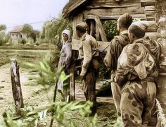 Peasant woman tells Soviet scouts the location of enemy units. North of the city of Orel 1943 Za Rodinu