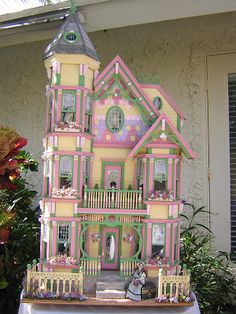 A gorgeous example of a doll house, I just love it. It's so pretty and colourful. I'd love to have one like it