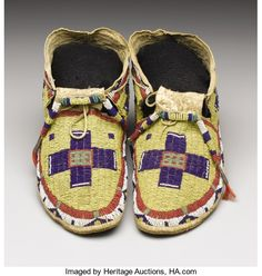American Indian Art:Beadwork, A PAIR OF SIOUX BEADED HIDE MOCCASINS. . c. 1885. ... (Total: 2Items)