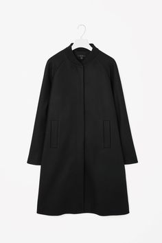 This long coat is made from a soft blend of wool and cashmere with a contrasting ribbed neckline. Flaring slightly towards the hemline for an A-line shape, it has raglan sleeves, welt pockets and a hidden front button fastening.