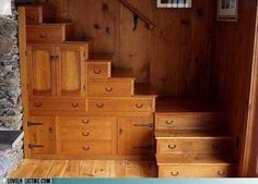 Storage drawers built into stairs. Reminds me of boat interiors where every inch is optimized.