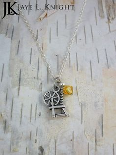Rumplestiltskin Inspired Spinning Wheel Charm Necklace with Your Choice of Color - Mr. Gold - Once Upon a Time by JayeLKnight on Etsy https://www.etsy.com/listing/224339105/rumplestiltskin-inspired-spinning-wheel