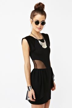 This dress with the mesh cutouts makes me really want to buy a peplum dress.