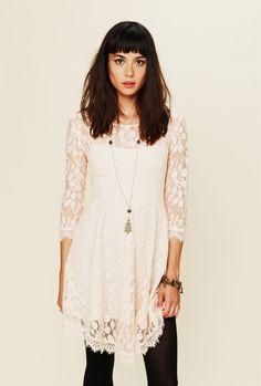 A white lace dress she can wear to bridal appointments. FreePeople.com