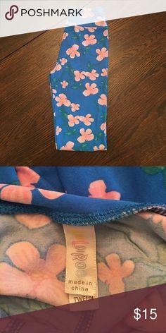 LuLaRoe tween leggings Lularoe size TWEEN leggings. Bright blue with pink cherry blossoms and green stems and leaves. Tween fits kids 8-14 and adult 00-0. LuLaRoe Pants Leggings