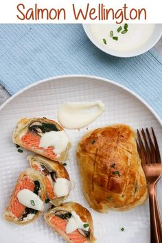 {ad} This Individual Salmon Wellington recipe features portioned puff pastry packets filled with spring greens, mushrooms, goat cheese, and salmon, along with an easy mustard sauce for an easy seafood dinner. #wellington #salmon #puffpastries #recipe #seafood #pescetarian via @champagneta0249