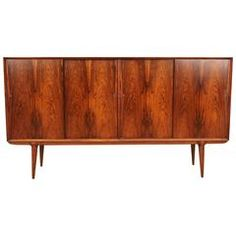 Midcentury Rosewood Credenza by Gunni Omann | From a unique collection of antique and modern buffets at https://www.1stdibs.com/furniture/storage-case-pieces/buffets/