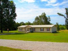 Country Home with 67 acres for sale near Salem, AR - $224,900. Relax in this beautiful Ozarks park like setting with a great view and 2 ponds. The manufactured home has been well maintained and has over 2,000 sq. ft. of living area. It includes 4/5 bedrooms, 3 baths, living room and family room. It has central H/A, range, gas fireplace, carpet, laminate, vinyl flooring, metal roof, walk in closets and plenty of storage. A 250 gallon propane tank is also included You can enjoy the great view.