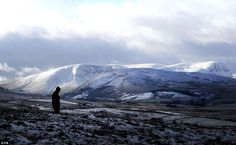 Rambling: A walker crosses the Pennine paths near Hawes in North Yorkshire, as blustery an...