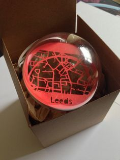 Handcut Papercut Map of Leeds protected inside a bauble - 8cm Diameter by BethaniePapercuts on Etsy
