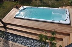 swim spa with softscaping rocks and steps on multiple sides....maybe