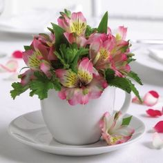 adorable table centerpiece idea - use brightly colored teacups